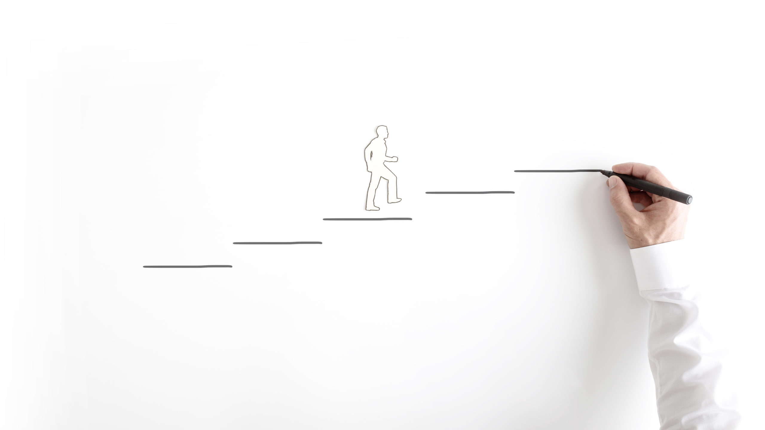 Paper silhouette cutout of a man and a businessman drawing steps